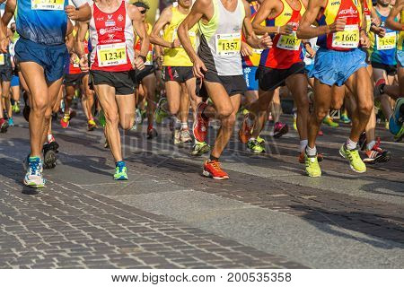 Parma, Italy - september 2016: International Marathon Running Race People Feet on City Road