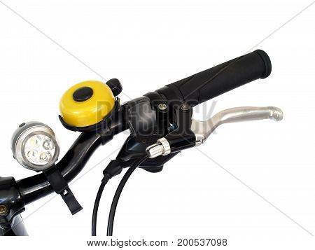 closeup bicycle handlebar with brake lever, yellow bicycle bell and led torch isolated on white background
