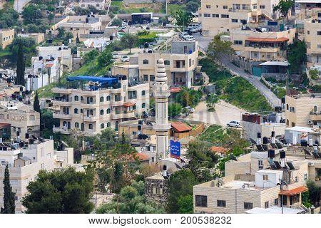 Jerusalem/ Israel - 12-04-2014: Minaret and buildings in East Jerusalem, Israel