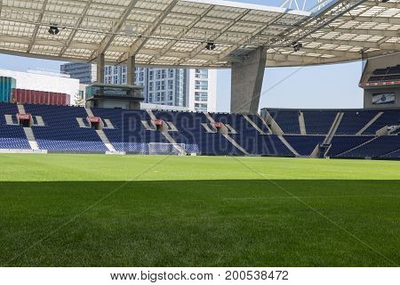 Blue Seatings Green Pitch and Gallery inside Empty Stadium Before Soccer Match