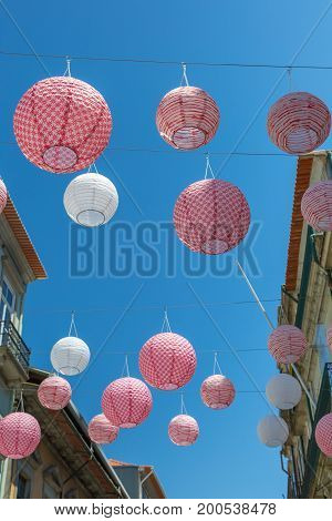 Pink Spherical Paper Lanterns Hanged In Porto Street Among Houses, Portugal