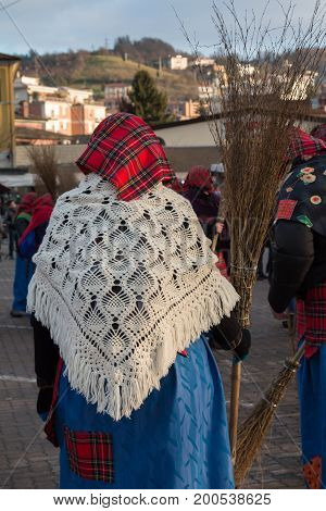 Befana Old Peasant Woman With Kerchief Shawl and Broom in Public Ground