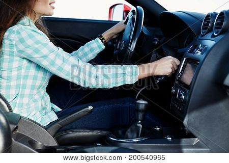 Attractive Girl Driving The Car