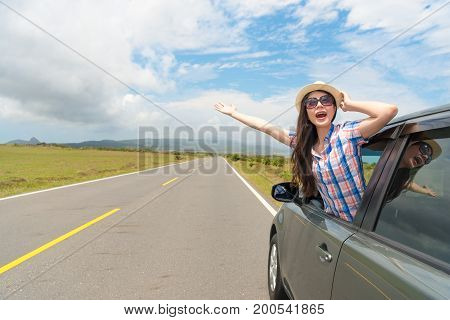 Smiling Girl Holding Hat Wearing Sunglasses