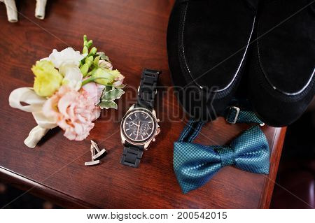Close-up Photo Of Groom's Wedding Shoes, Bow Tie, Watch, Cufflinks And Buttonhole Flowers.