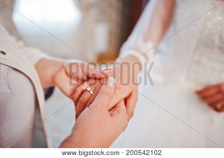 Close-up Photo Of A Mother Holding Her Daughter's Hand On Her Wedding Day.