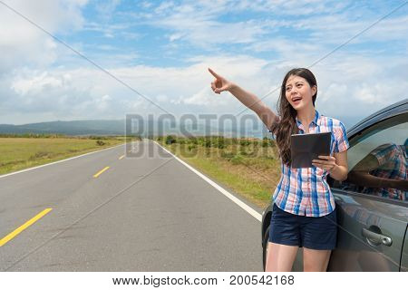Girl Happily Pointing Famous Pastoral Scenery