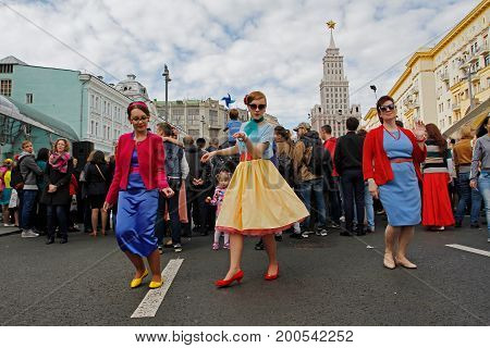 Moscow Russia - September 10 2016: Women dancing in installation dedicated to the film