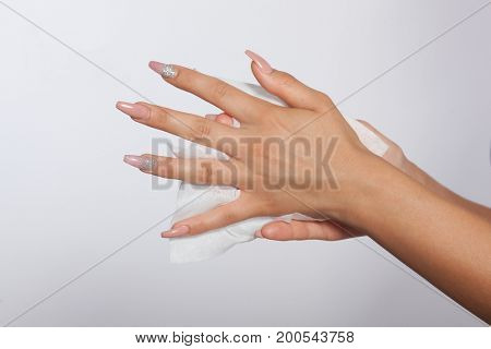 Cleaning hands with long nails with wet wipes