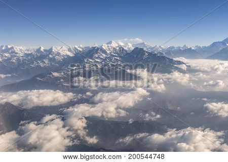 Daylight view of Mount Everest Lhotse and Nuptse and the rest of Himalayan range from air. Sagarmatha National Park Khumbu valley Nepal.