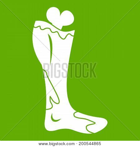 Zombie leg icon white isolated on green background. Vector illustration