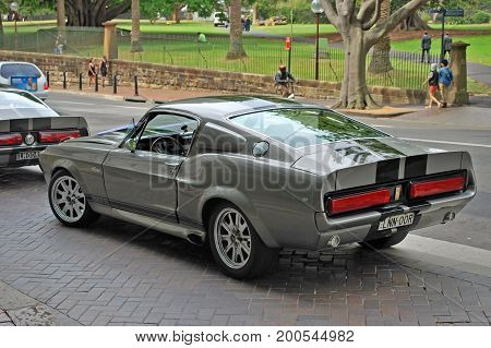 SYDNEY, AUSTRALIA - NOVEMBER, 02, 2015: Classic car models of Shelby 1967 Mustang GT500 parked on a street - view from behind