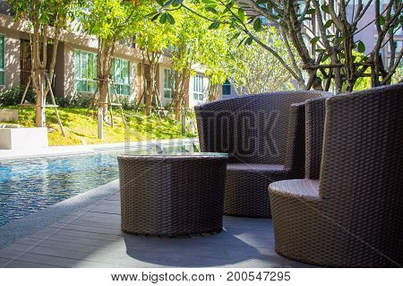 Chairs And Table Near Swimming Pool