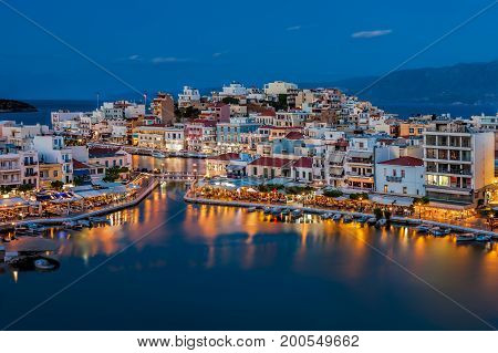 Agios Nikolaos Crete Greece. Agios Nikolaos is a picturesque town in the eastern part of the island Crete built on the northwest side of the peaceful bay of Mirabello.