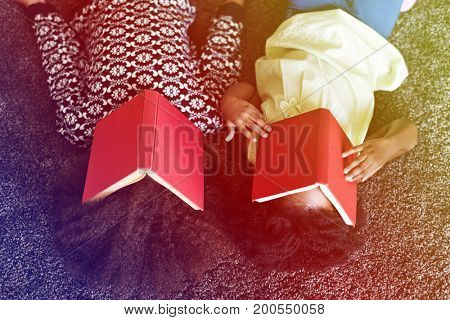 African sisters take a rest from reading books