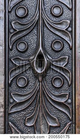Keyhole in the old forged door. Close-up.