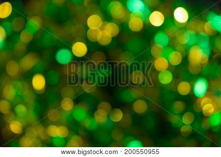 Yellow-green lights out of sharpness on the window