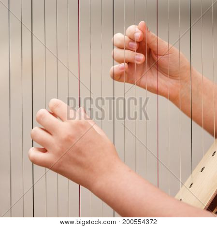 Hands on the strings of a cello