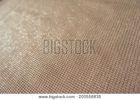 Close Up Of Shiny Beige Polyester Fabric