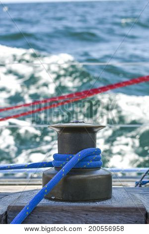 Kabestan with a rope on the background of the North Sea during a sailing yacht cruise.