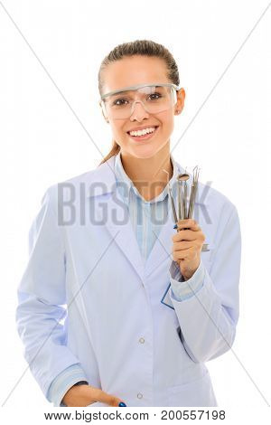 Beautiful female dentist doctor holding and showing a toothbrush isolated on a white background. Dentist doctor