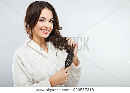 Gorgeous Girl Wearing Bath Robe Holding A Hair Brush