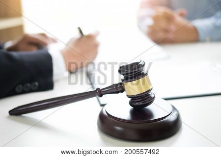 Judge Gavel With Lawyers Advice Legal At Law Firm In Background. Concepts Of Law, Services
