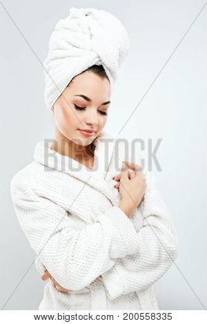 Pretty Girl With Dark Hair Wearing Bath Robe And Towel