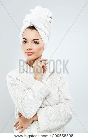 Beautiful Girl With Dark Hair Wearing Bath Robe And Towel