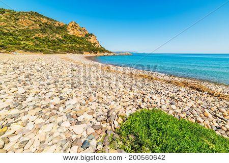 Pebbles in Baccu e Praidas shoreline. Sardinia Italy