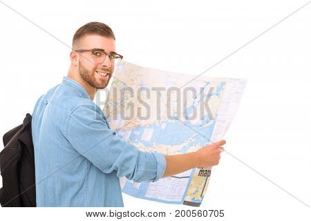 Young man holding at map on white background. Young man holding a map on a white background. A tourist on vacations. Looking for sights. Adventures seeker.