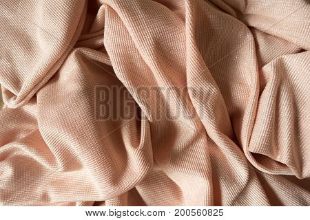 Rippled Cream Colored Polyester Fabric With Metallic Shine