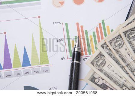 pen money graph concept for business finance.