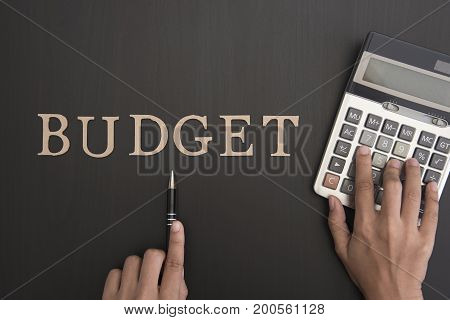 accountant with calculator and Budget alphabet on desktop. concept business finance.