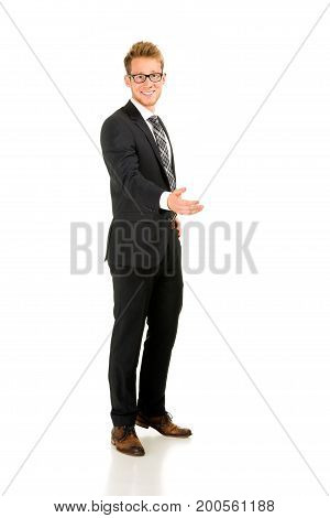 Young, handsome business man full-length portrait. Isolated on the white background.