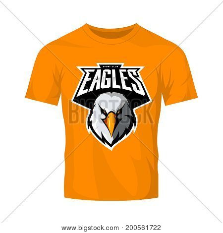 Furious eagle head athletic club vector logo concept isolated on orange t-shirt mockup.  Modern sport team mascot badge design. Premium quality wild bird emblem t-shirt tee print illustration.