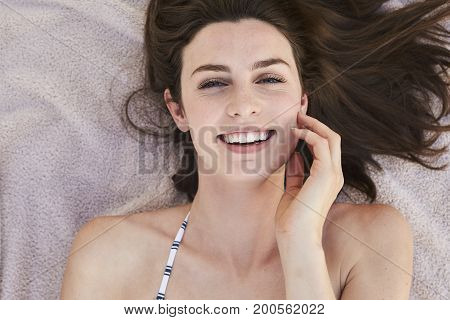 Laughing beautiful brunette woman smiling to camera