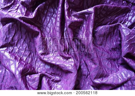Folded Glossy Bright Violet Viscose Fabric From Above