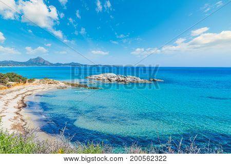 Scoglio di Peppino shoreline on a sunny day. Sardinia Italy