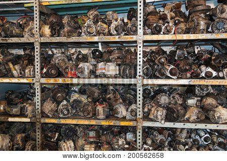 Car breaker shelf full of used engine parts