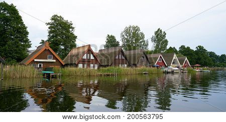 GRANZOW, GERMANY - JUNE 28, 2016: Boat houses in the resort of Granzow in the Mueritz Nationalpark. The boat houses are gladly rented by tourists.