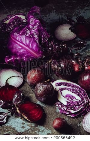 Beautiful Dark Background With Fruits And Vegetables Of One Color: Blue Cabbage, Beets, Onions, Basi