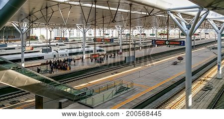 Tianjin, China - Nov 1, 2016: Proceeding to the boarding platform in Tianjin Railway Station. Elevated view of the platform areas.