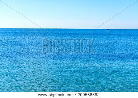 Blue water in Alghero shoreline. Sardinia Italy