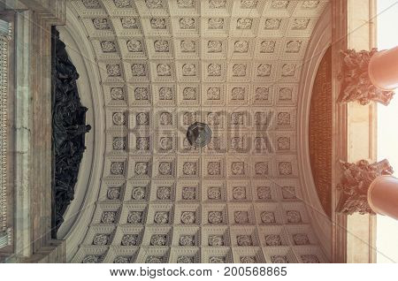 Architecture background of St Petersburg Russia landmark. Colonnade and the ceiling architecture details of the St Isaac Cathedral in St Petersburg Russia - architecture closeup view