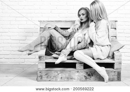 Women Embrace On Sofa