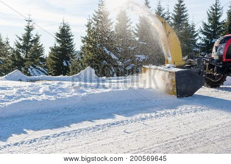 Snow removal machine in action after snowfall
