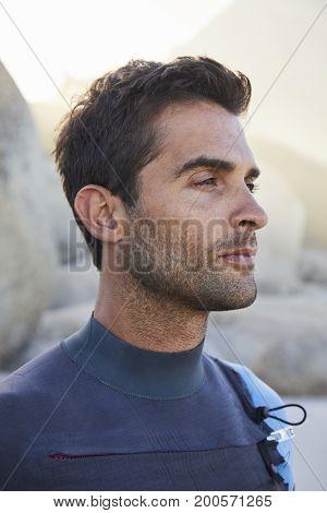 Handsome wetsuit guy in profile looking away