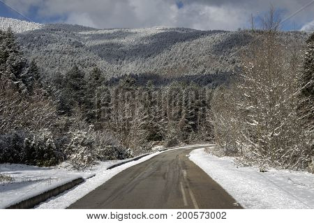 Rural road in the picturesque mountains on a winter day