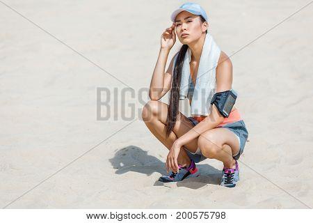 Sportswoman Resting With Towel